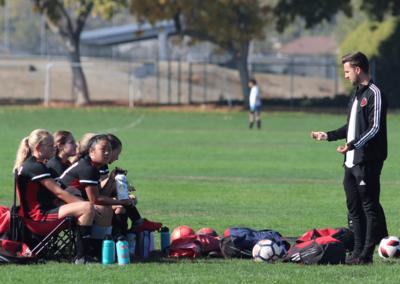Red Star Coach Chris McKenna talking to girls soccer team